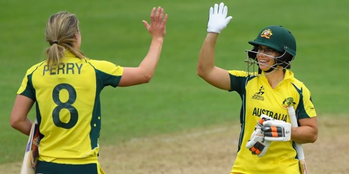 TAUNTON, ENGLAND - JUNE 26:  Australia batsman Nicole Bolton (r) and  Ellyse Perry celebrate victory during the ICC Women's World Cup 2017 match between Australia and West Indies at The Cooper Associates County Ground on June 26, 2017 in Taunton, England.  (Photo by Stu Forster/Getty Images)