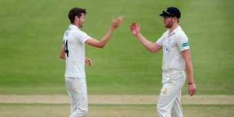CHELTENHAM, UNITED KINGDOM - JULY 21: David Payne of Gloucestershire (L) celebrates after taking the wicket of Charlie Shreck of Leicestershire to reach his five wicket haul during Day Two of the Specsavers County Championship Division Two match between Gloucestershire and Leicestershire at The College Ground on July 21, 2016 in Cheltenham, England. (Photo by Harry Trump/Getty Images)